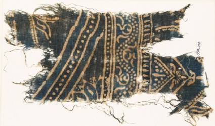 Textile fragment with dotted vine and row of dots