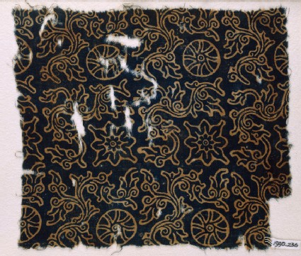 Textile fragment with rosettes or wheel-shapes, flowers, and plants