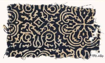Textile fragment with floral quatrefoil, tendrils, and foliage