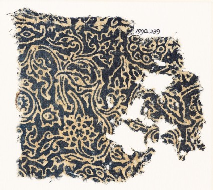 Textile fragment with swirling plants and flower-heads