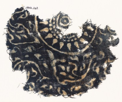 Textile fragment with medallion, rosette, and stylized leaves