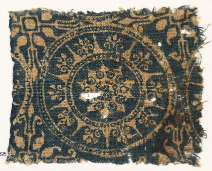 Textile fragment with medallion and stars