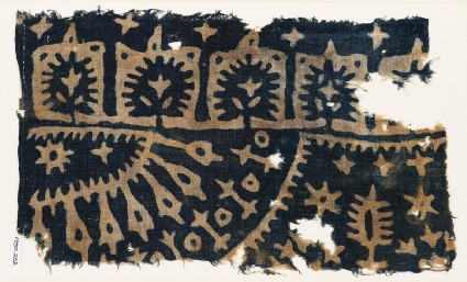 Textile fragment with trees, stars, and radiating shapes