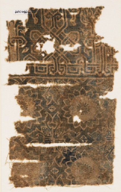 Textile fragment with rosettes, quatrefoils, and interlace based on script