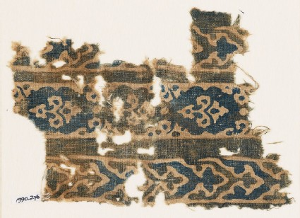 Textile fragment with bands of flowers and elaborate chevrons