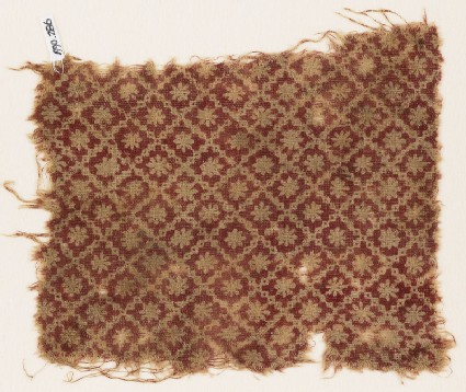 Textile fragment with stepped squares and rosettes