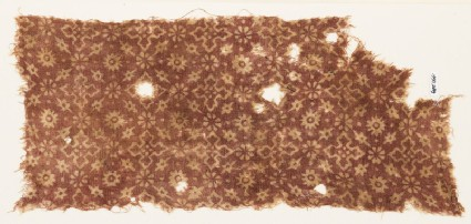 Textile fragment with stars, rosettes, flower-heads, and crosses