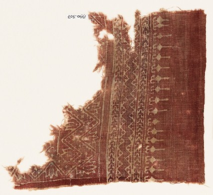Textile fragment with chevrons, trefoils, and stylized leaves