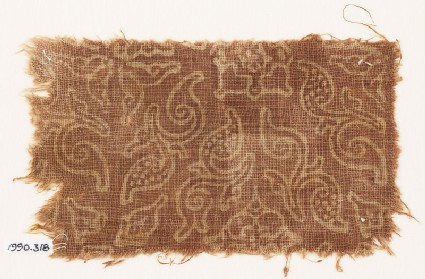 Textile fragment with stylized plants and quatrefoils