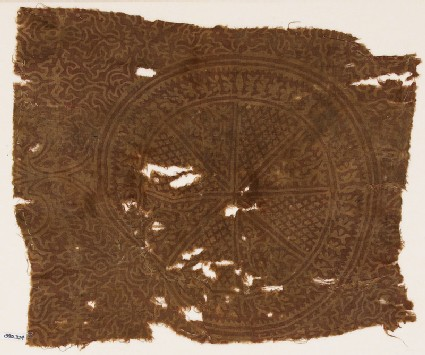 Textile fragment with circle, tendrils, and stylized plants