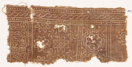 Textile fragment with rosettes and inscription