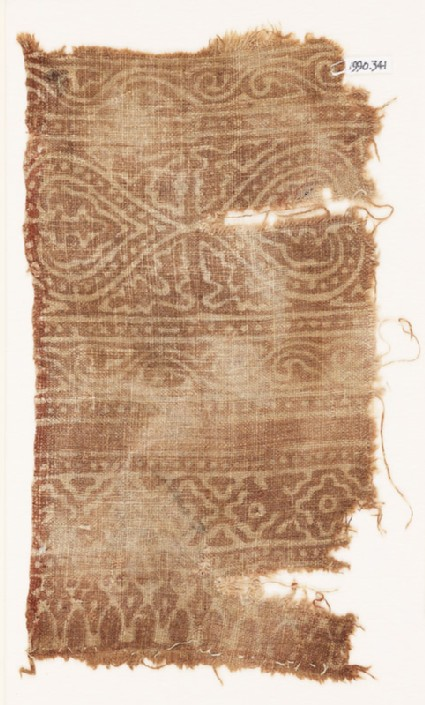 Textile fragment possibly imitating patola pattern, with hearts or leaves