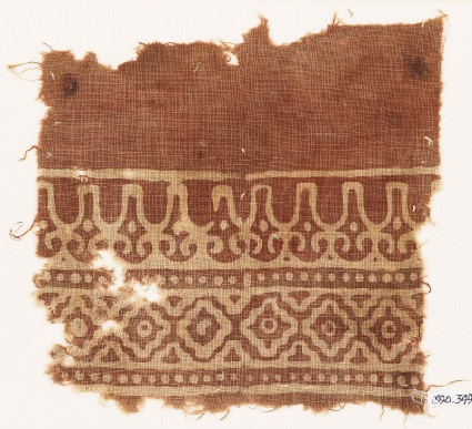 Textile fragment with linked diamond-shapes and stylized leaves