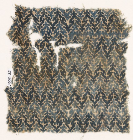 Textile fragment with linked chevrons and trefoils