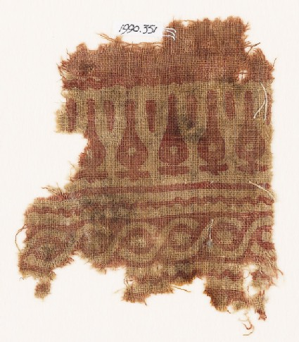 Textile fragment with stylized leaves and cable pattern