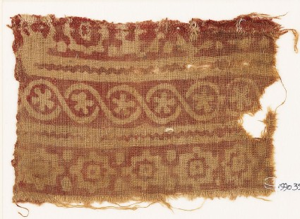 Textile fragment with stepped squares, cable pattern, and flowers