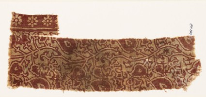 Textile fragment with stylized tendrils and leaves