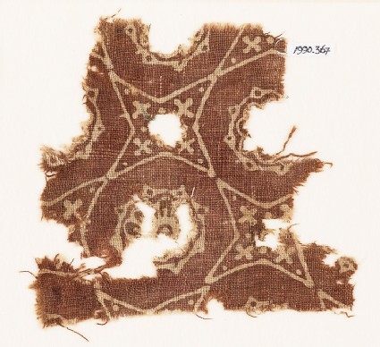 Textile fragment with four-pointed stars and rosettes