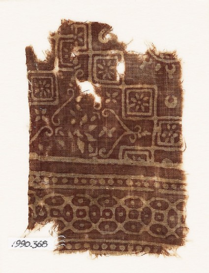 Textile fragment with squares, rosettes, and interlocking quatrefoils