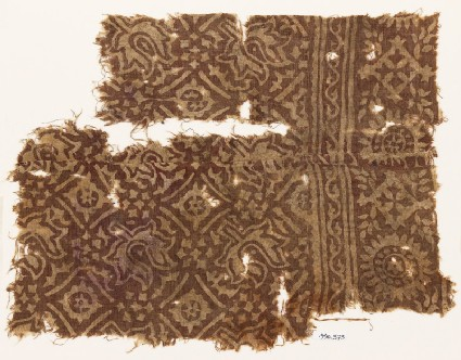Textile fragment with flower-heads, stars, and squares