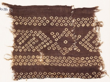 Textile fragment imitating bandhani, or tie-dye, with stars and inverted hooks