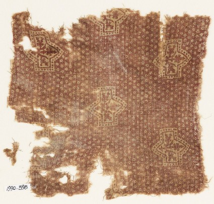 Textile fragment with large plants and possibly bandhani, or tie-dye, imitation