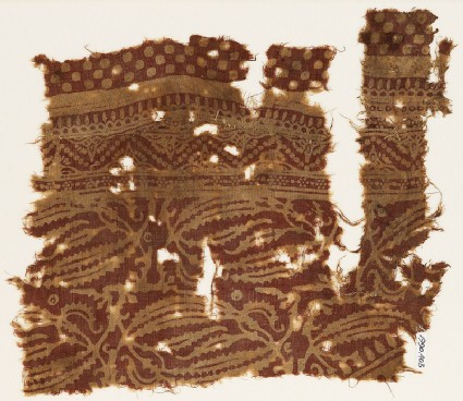 Textile fragment with plants with long leaves