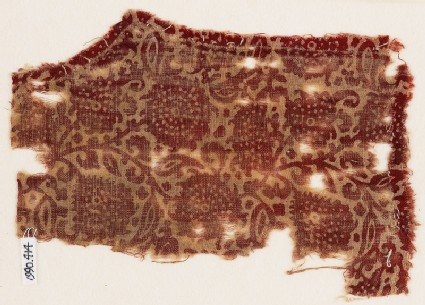 Textile fragment with leaves and flower-heads, possibly from a garment