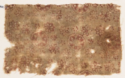 Textile fragment with large and small rosettes