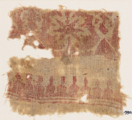 Textile fragment with flower and interlace