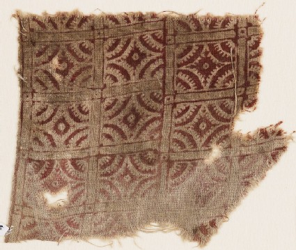 Textile fragment with lines intersecting circles