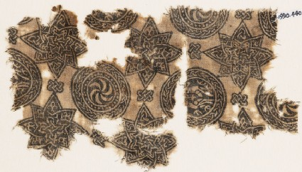 Textile fragment with spirals in braided circles, and stars