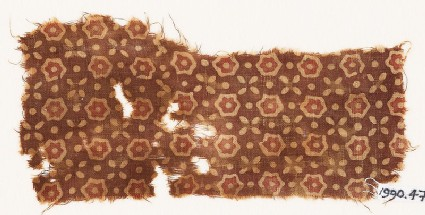 Textile fragment with stars, quatrefoils, and dots