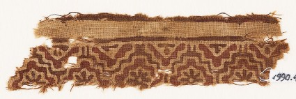 Textile fragment with linked stepped squares and rosettes