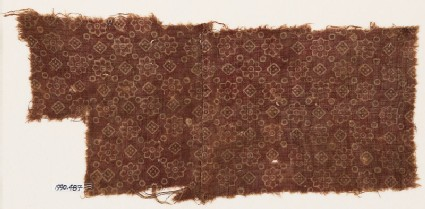 Textile fragment with rosettes, dots, and small squares