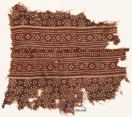 Textile fragment with rosettes, dots, and lobed diamond-shapes