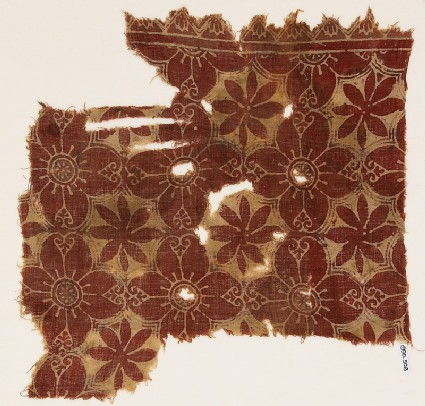 Textile fragment with linked quatrefoils and rosettes