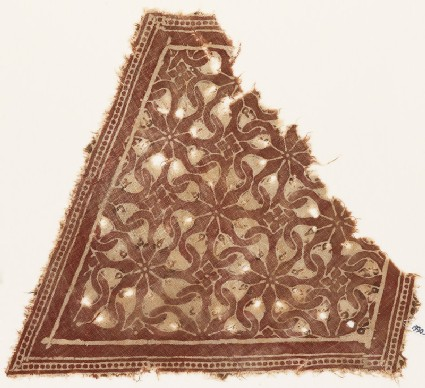 Textile fragment with interlocking spirals or rosettes