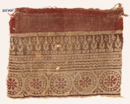 Textile fragment with rosettes in dotted circles, and abstract plants