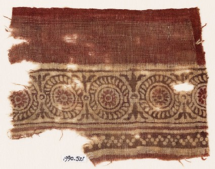 Textile fragment with rosettes in dotted frames