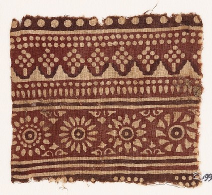 Textile fragment with rosettes and dots