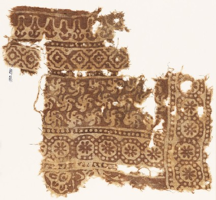 Textile fragment with bands of rosettes in dotted circles, spirals, and diamond-shapes