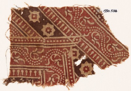 Textile fragment with bands of dotted vines, rosettes, and diamond-shapes