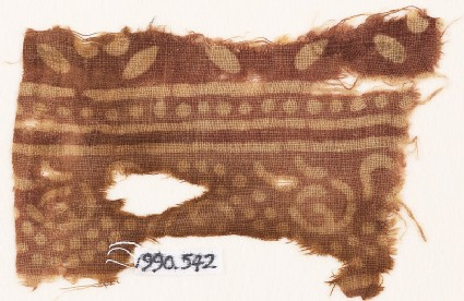Textile fragment with dots and leaves