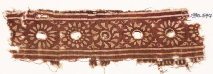 Textile fragment with band of rosettes
