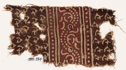 Textile fragment with stylized tendrils or hooks, and a dotted vine