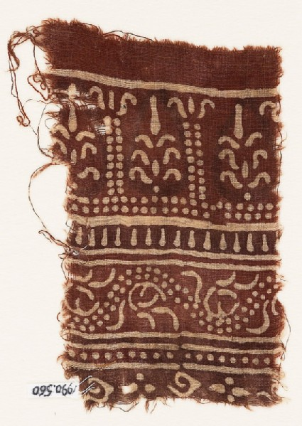 Textile fragment with columns, stylized trees, and dotted vine