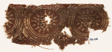 Textile fragment with star-shaped flowers in dotted circles