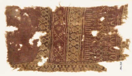 Textile fragment with circles, tendrils, rosettes, and arches