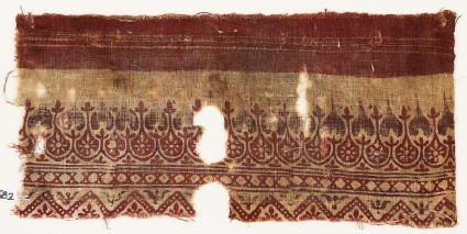 Textile fragment with leaves, rosettes, diamond-shapes, and zigzag